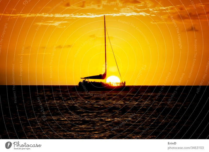 Sunset Sail with Sun Dropping Below Horizon and Boat sunset sky ocean sea water light color colorful twilight beauty beautiful silhouette boat horizon seascape