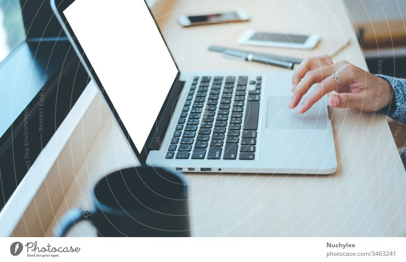 Close up hands of young businesswoman typing on computer laptop with blank screen at the office or cafe, business concept asian brainstorming busy casual