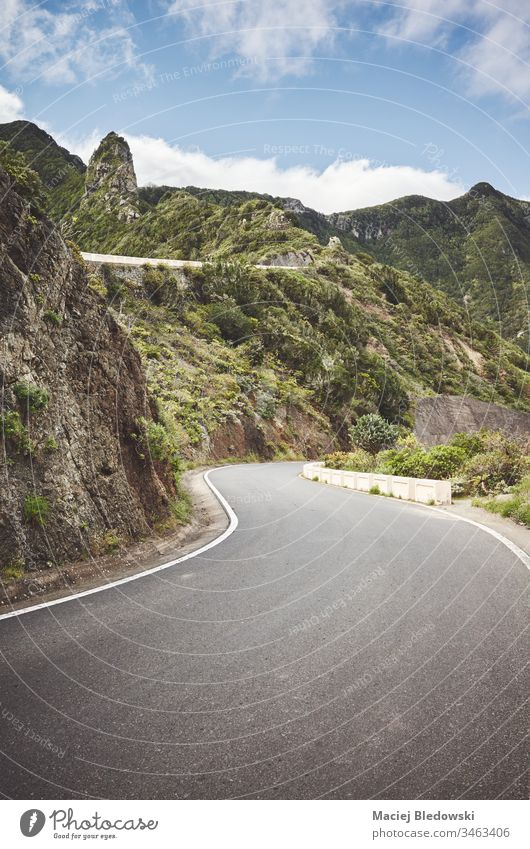 Scenic mountain road in Anaga Rural Park, Tenerife. trip travel landscape journey Spain Canary Islands drive Macizo de Anaga way sky filtered asphalt scenery