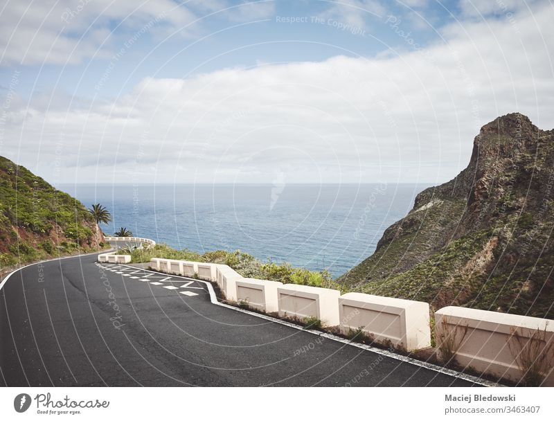 Scenic ocean drive in Anaga Rural Park, Tenerife, Spain. road trip mountain travel landscape journey Canary Islands Macizo de Anaga way sky filtered asphalt