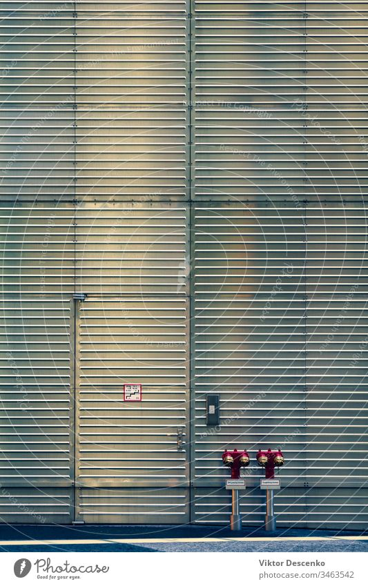 Fire hydrants at the corrugated wall and door background design abstract water pattern texture construction steel iron security metal urban building gray fire