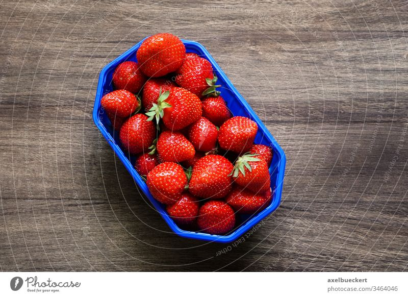 topview of strawberries on wooden background strawberry fruit food garden strawberry vitamin C basket container red ripe german Fragaria ananassa vegetarian