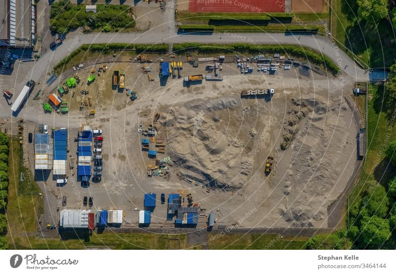 Construction area from top view of a drone construction aera work container sand earth build up transport drive new high aerial dirt built upfrom above copter