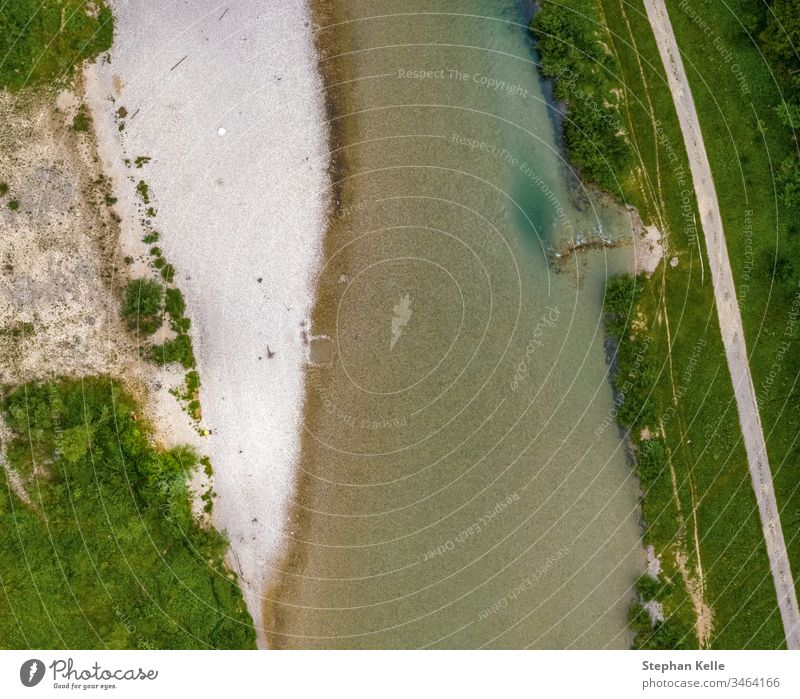 Top view at a river with with sand at the shore and green vegetation. top view drone water white pure nature Landscape Beautiful clear seascape copter