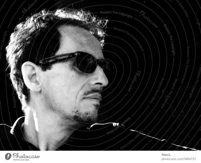 Through his distinctive sunglasses, the striking man looked strikingly into the distance. Man Human being Portrait photograph Black & white photo Facial hair