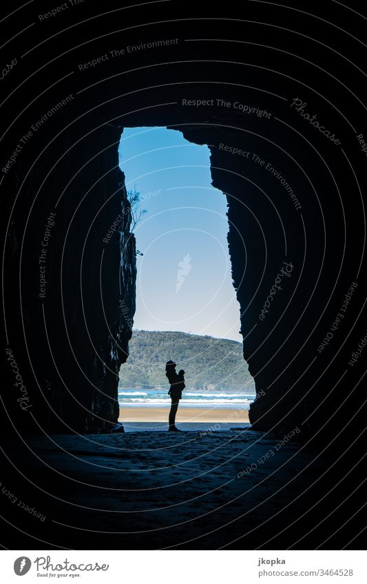 Woman in cave at the beach New Zealand Identity Vacation & Travel Moody Tourism Colour photo Exterior shot Light Shadow Silhouette Blur Nature Adventure