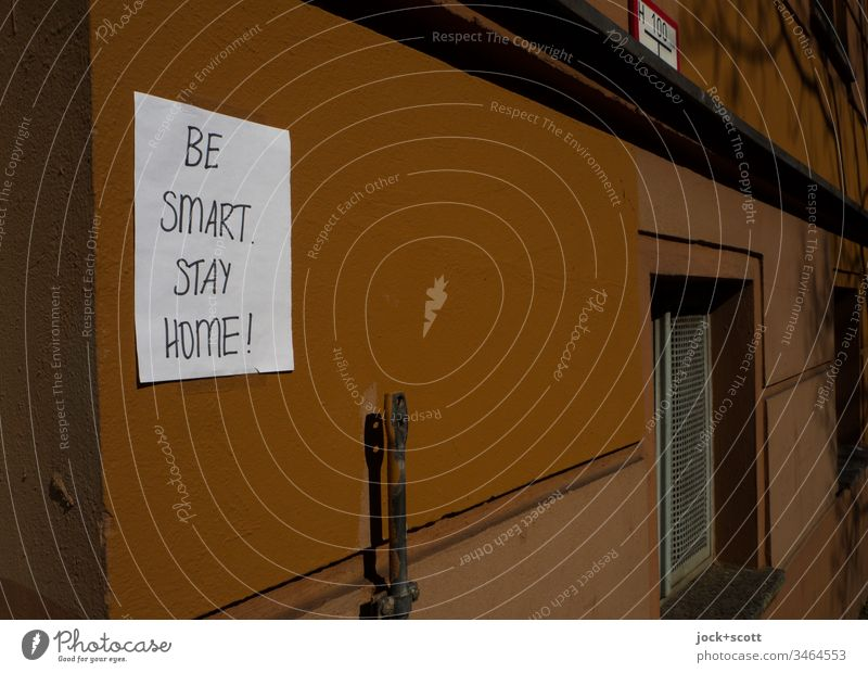 # Be smart and stay home Dark Window Subdued colour Low-key Piece of paper Handwriting Stuck on Epidemic pandemic covid-19 coronavirus Clue Quarantine