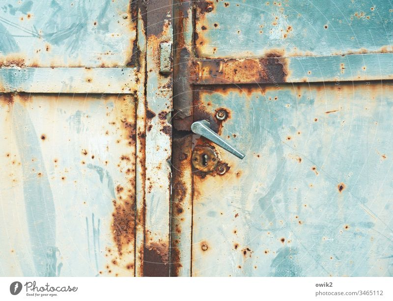 Hanging handle Goal Old door handle Metal Rust Trashy Decline Tracks Ravages of time Colour Turquoise Blue russet Detail Deserted Transience Destruction