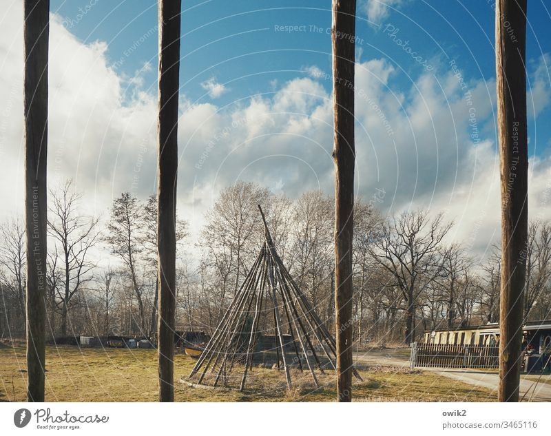 Through the bars Tee Pee tipi village Lausitz forest Scaffolding Framework trees Sky Clouds rods tent poles Joist Wood Long Thin Empty Exterior shot Deserted