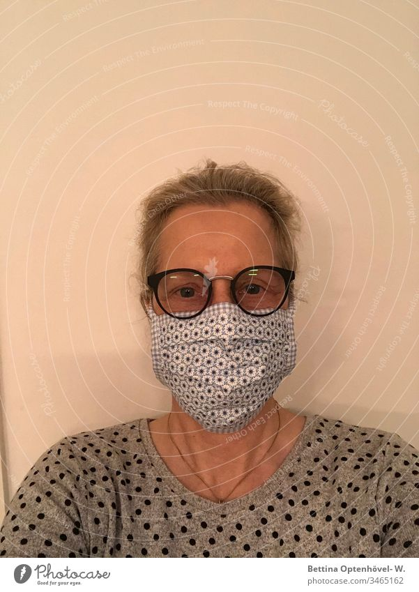 Woman with self-sewn protective mask corona pandemic Quarantine prevention Infection