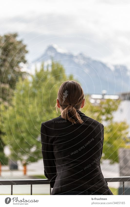 Woman on terrace with view to the mountains Handrail Balcony Business Sky Relaxation Landscape recover jacket Suit University & College student hair Forward