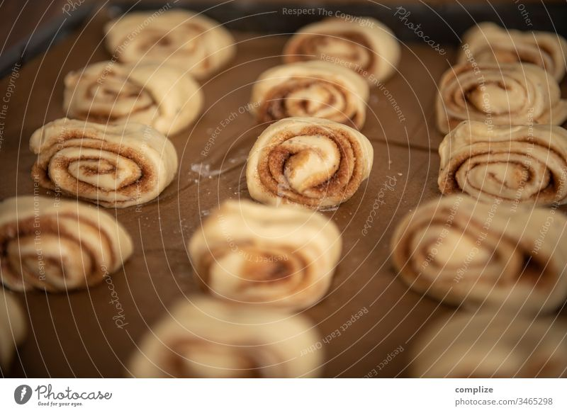 Korvapuusti - Finnish cinnamon buns biscuits Baking tray Delicious back open Tin Sugar Baker at home baking paper Tradition Cinnamon Cardamom