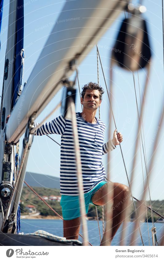 Young man on a sailboat white beauty nature health sea transportation summer travel mediterranean water lifestyle portrait light tourism young alone cruise ship