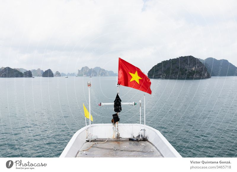 vietnam flag on a boat Halong Vietnam asia banner basin composure emblem freedom harbor lagoon lake landscape nature no person outdoors pond reservoir sea ship