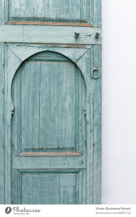 old door painted green Marrakech Morocco africa aquamarine architecture blue dirty doorway entrance exit family gate house interior design lock lumber no person