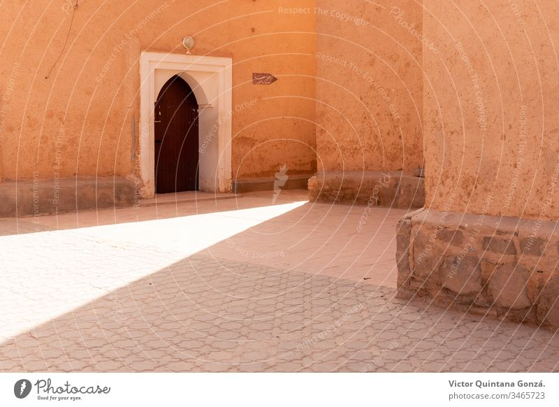 Moroccan street with sunbeam African Berber Marrakech Morocco adobe africa ancient antique arch architecture art building courtyard door no person old outdoors