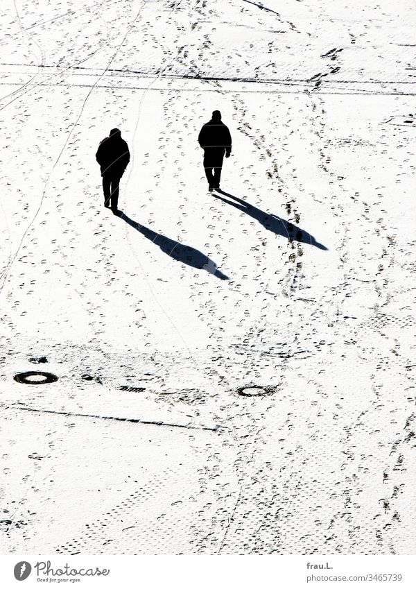 As if cloned and yet strange, the two men trudged past each other in the snow. Snow Winter Places Man Black & white photo Cold Tracks Shadow Sunlight