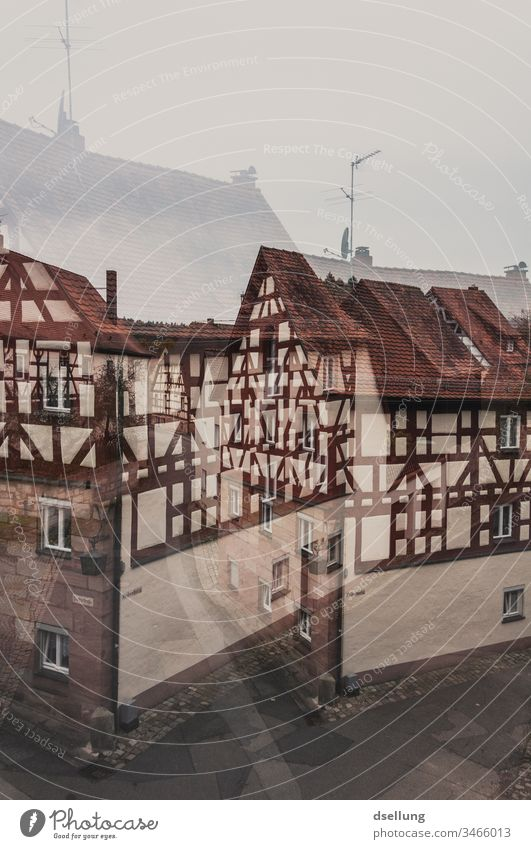 Double exposure of a street with half-timbered houses Escape from reality Really Dream Vacation & Travel Tourism Inverted Castle in the air Sustainability