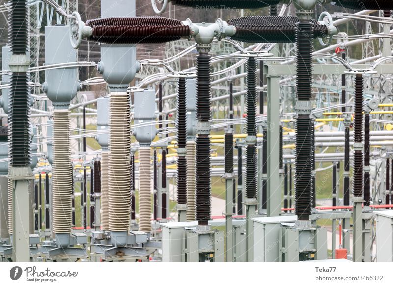 modern high-voltage substation background high voltage high voltage substation energy electricity steel amp green grey yellow sharp blur high voltage pylon