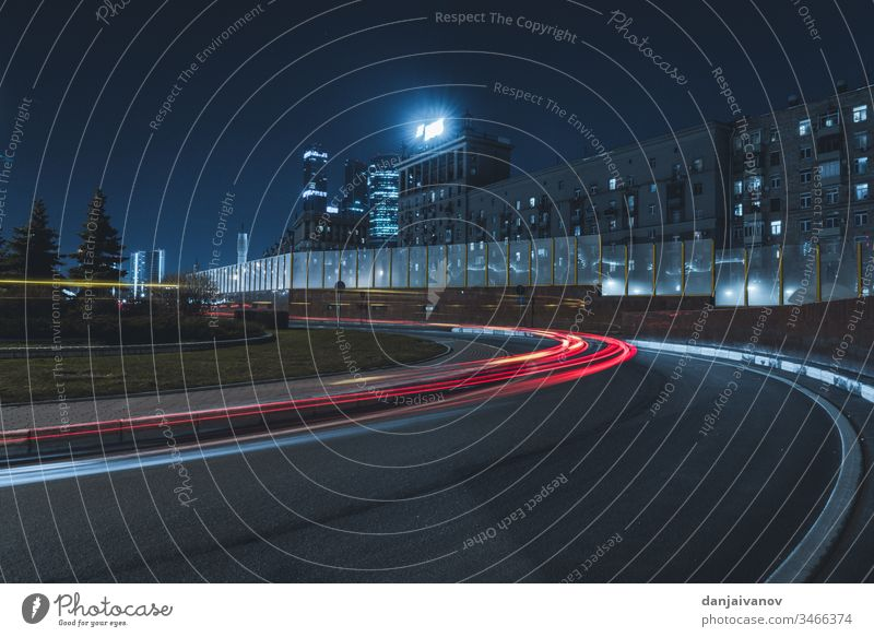 Long-exposure photograph night road city traffic light street car speed highway urban blur transportation travel fast building cars business downtown vehicle