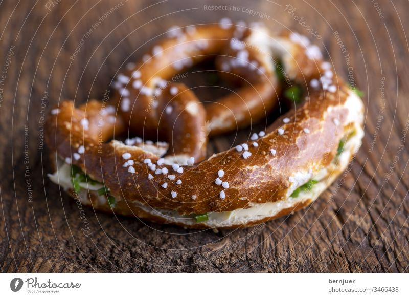 Bavarian pretzel with butter on wood Pretzel Butter Butter pretzel cut spawn Wood Breakfast Oktoberfest Baking Eating Bread Germany traditionally Munich