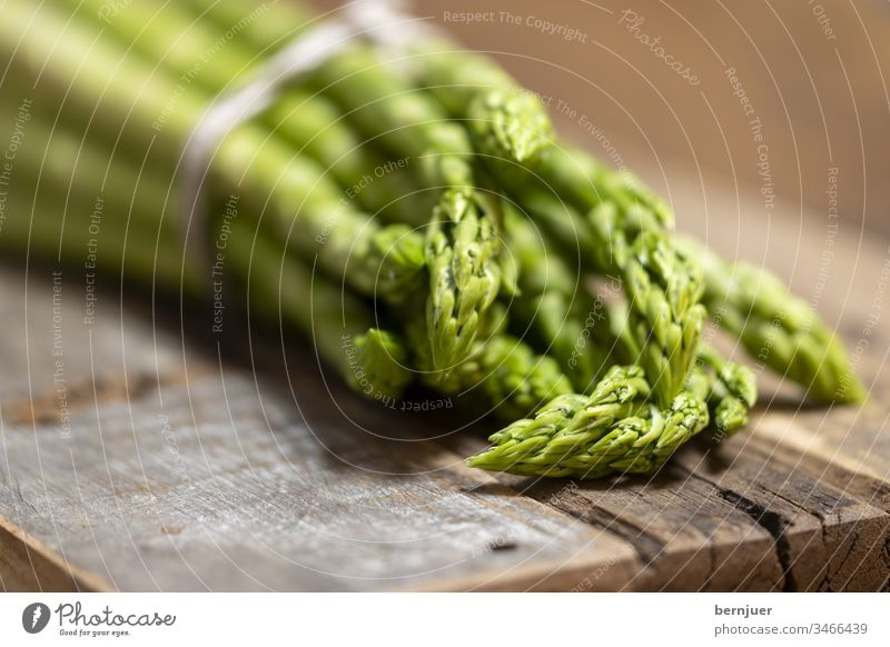 Close up of raw green asparagus Asparagus Green Heap salubriously Nutrition Food Raw ingredient organic Diet Wood vegetarian Vegetable background Fresh Vitamin