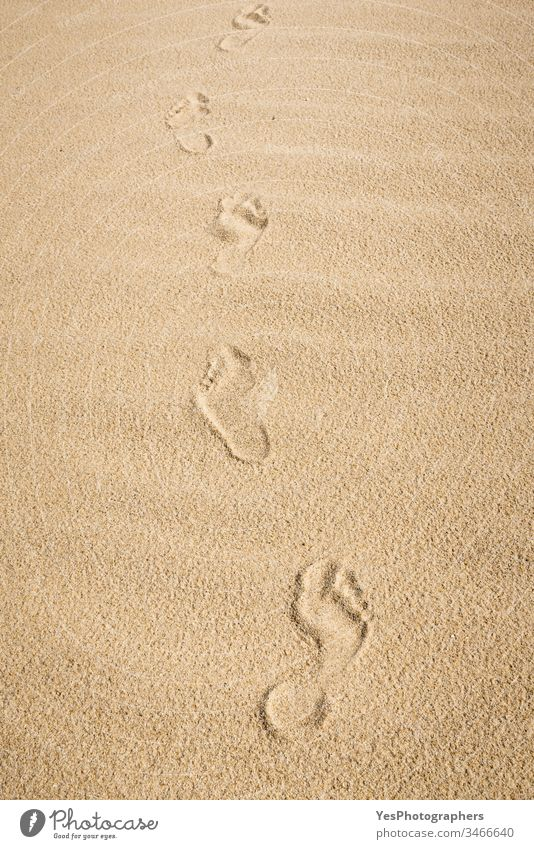 Barefoot footprints on sand. Walk on the beach German beach on one's own background naked feet Beach European island fine sand Footpath footsteps Heat