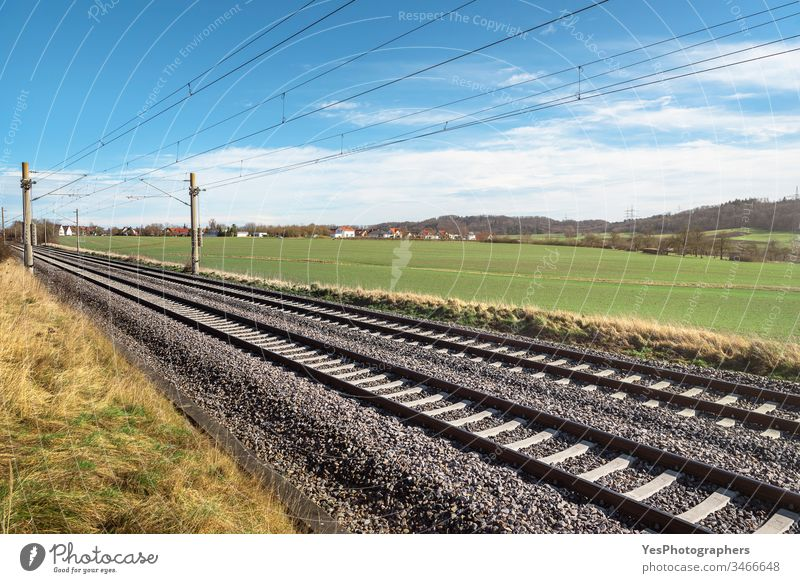Railroad tracks through green meadow. German rail infrastructure Germany connection direction europe freedom german rail journey landscape logistic nature