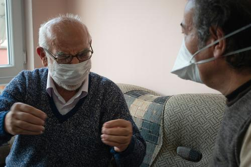 Elderly wearing mask telling his problems about coronavirus turkey turkish corona virus quarantine curfew infection europe street home indoor stayhome