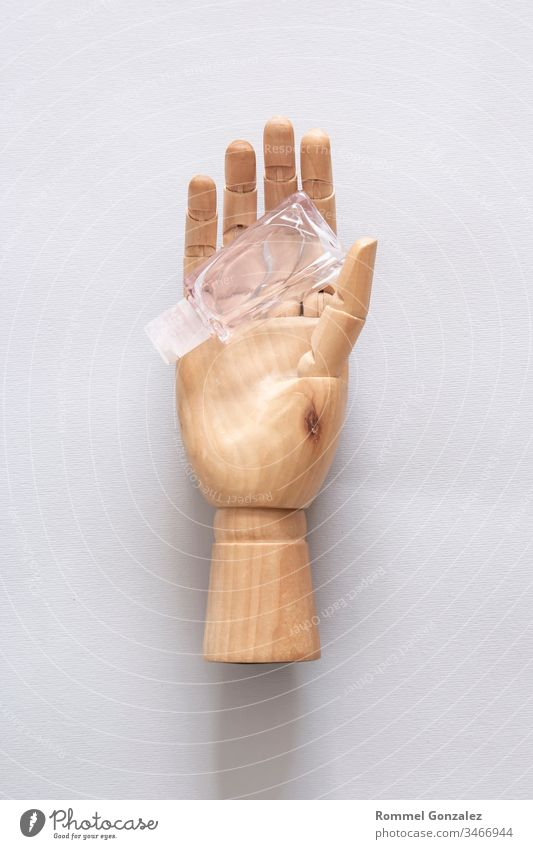hand wooden, Virus prevention and treatment: wearing masks, hand disinfection, taking precautions. First aid kit with medicines on a blue background. hand wood