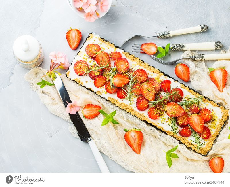 Home made strawberry not baked cheese cake ricotta background gray cream delicious fruit mint food sweet fresh home made pastry pie enamel tin summer dessert