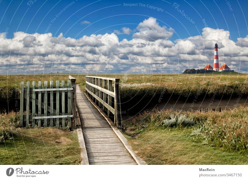 Westerhever Lighthouse Westerhever lighthouse Schleswig-Holstein cloud landscape Clouds in the sky Footbridge Exterior shot marshland Gate Wooden gate out
