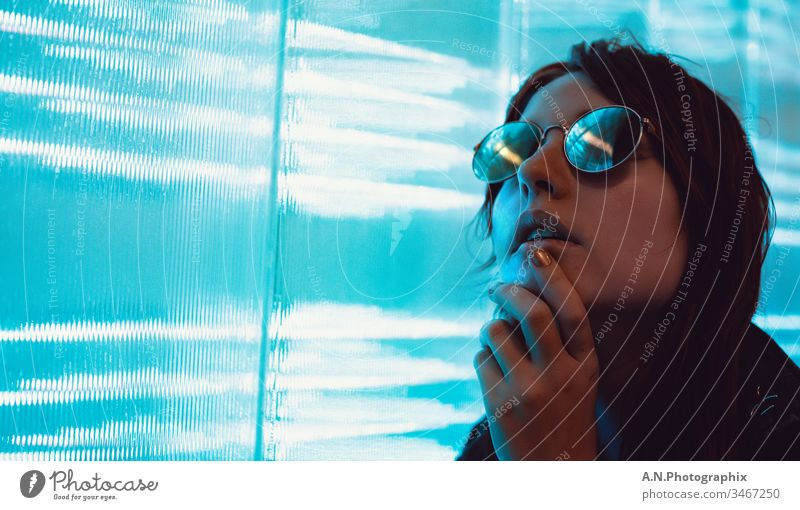 Portrait of a woman with glasses next to an LED wall Portrait photograph portrait photographer portrait photography Eyeglasses feminine Woman