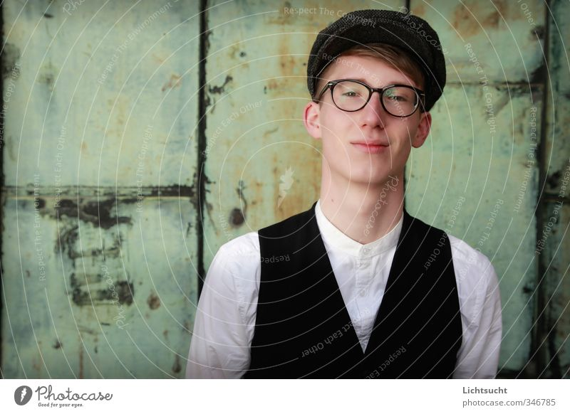 Against a green background University & College student Masculine Young man Youth (Young adults) 1 Human being Shirt Vest Eyeglasses horn-rimmed glasses Cap