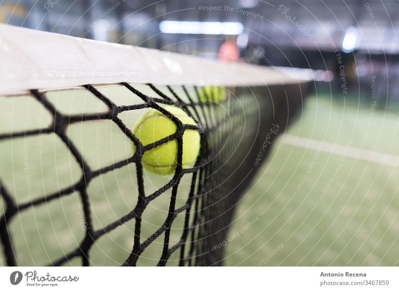 Ball shot versus the net paddle-tennis padel paddle tennis ball sport sports recreation equipment nobody focus in foreground leisure bokeh indoors fail failure