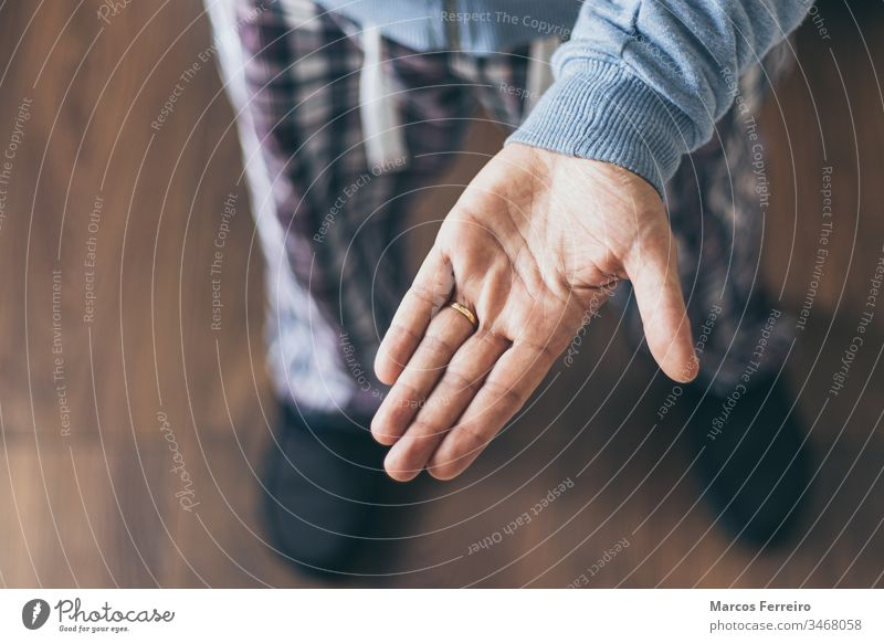 outstretched hand top view. Hand gestures. Confined person adult alone arm background caucasian concept confined empty extended finger give home human interior