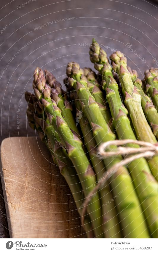 bunch of green asparagus Asparagus Green federation Vegetable Food Nutrition Vegetarian diet Organic produce Healthy Eating Close-up Fresh Bunch of asparagus