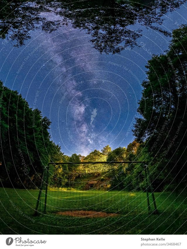 The Galactic Center of the Milky Way in the sky above the goal of a soccer field excluded. Milky way Goal Playground Room starlit Astrophotography background
