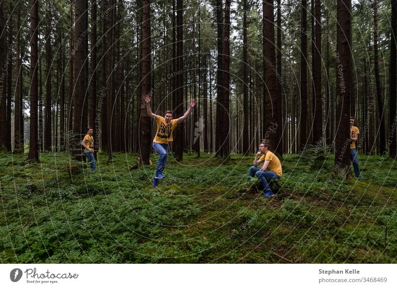 Fun in a forest, multiple selfie in different poses. Selfie tree nature Photoshop green fun hide jump person man Men same Colour photo Exterior shot landscape