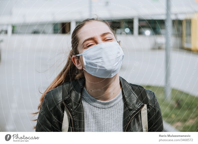Young woman enjoy the sun with mask for protection from coronavirus covid-19 air air mask blonde caucasian corona epidemic corona italy corona virus dark end
