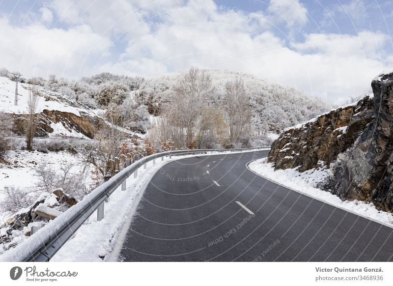 curved road in snowy landscape cold drive europe fog frost frosty frozen guidance ice lane mountain nature palencia route sky slippery snowstorm spain