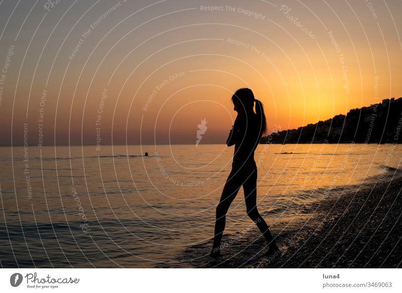 Girls at sunset on the beach Beach Ocean Sunset Silhouette bathe cheerful fortunate Rock Joy Stand Tourism Croatia Mediterranean sea Coast vacation free time