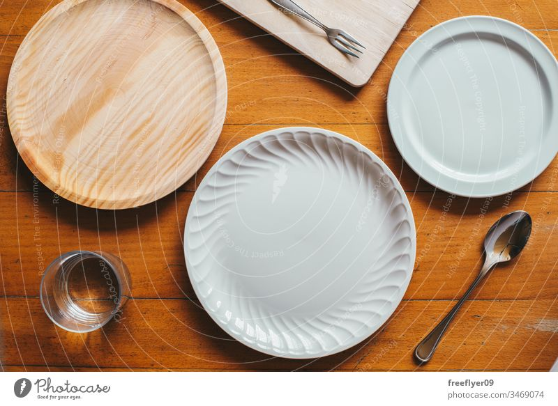 Flat lay of three plates and some cutlery mockup mock up flatlay flat lay kitchen cuttlery wood porcelain white wooden table from above cenital empty cook lunch
