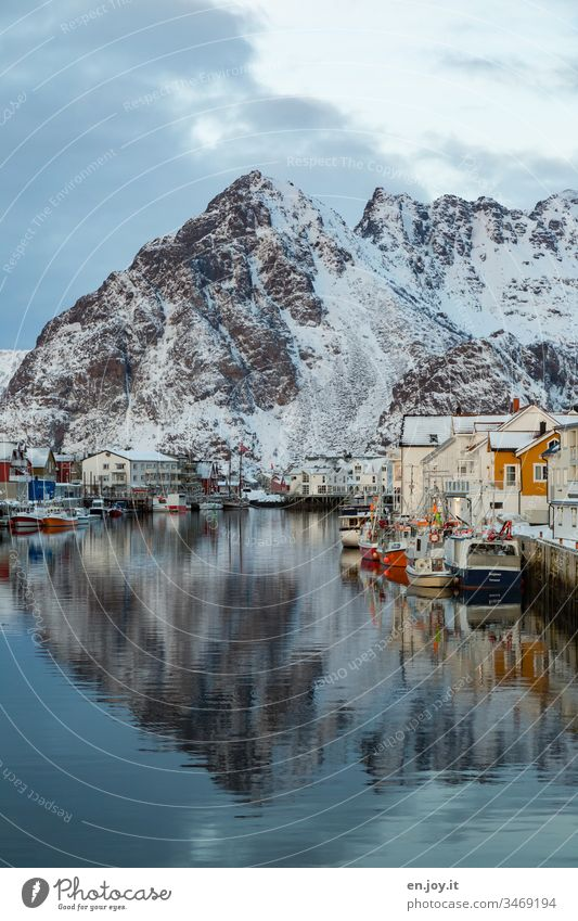 Harbour with boats and houses with reflection in front of snow-covered mountains in Hennigsvaer Henningsvær Lofotes Lofoten Islands Norway Nature Norway 2015