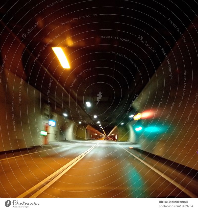 Drive through an illuminated car tunnel car tunnels Tunnel Transport Street Light Highway conceit Night Traffic infrastructure Tunnel vision road tunnels