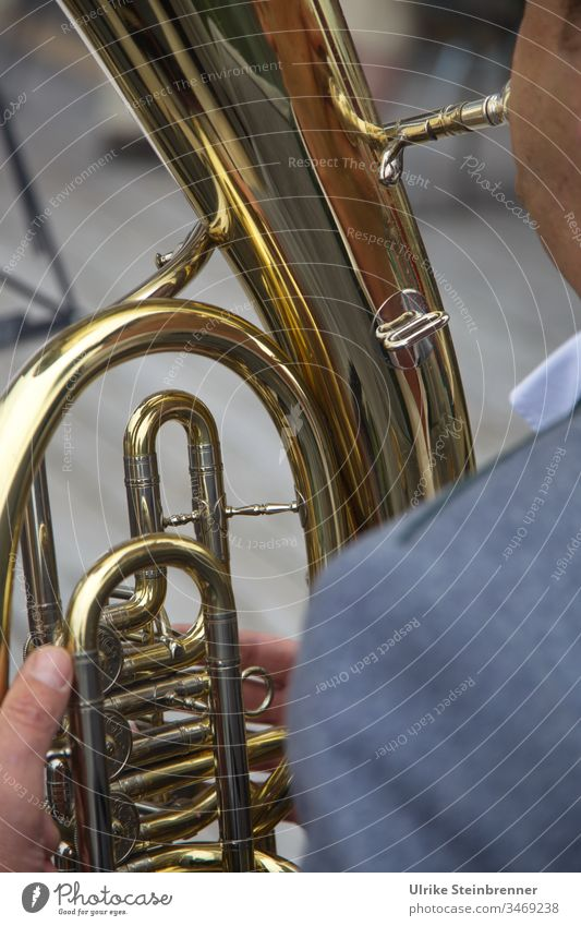 Detail of a tenor horn in Allgäu brass band Brass instrument Brass band Music Chapel Tuba player Musician Tin golden valves Fingers Folklore music Indian ink