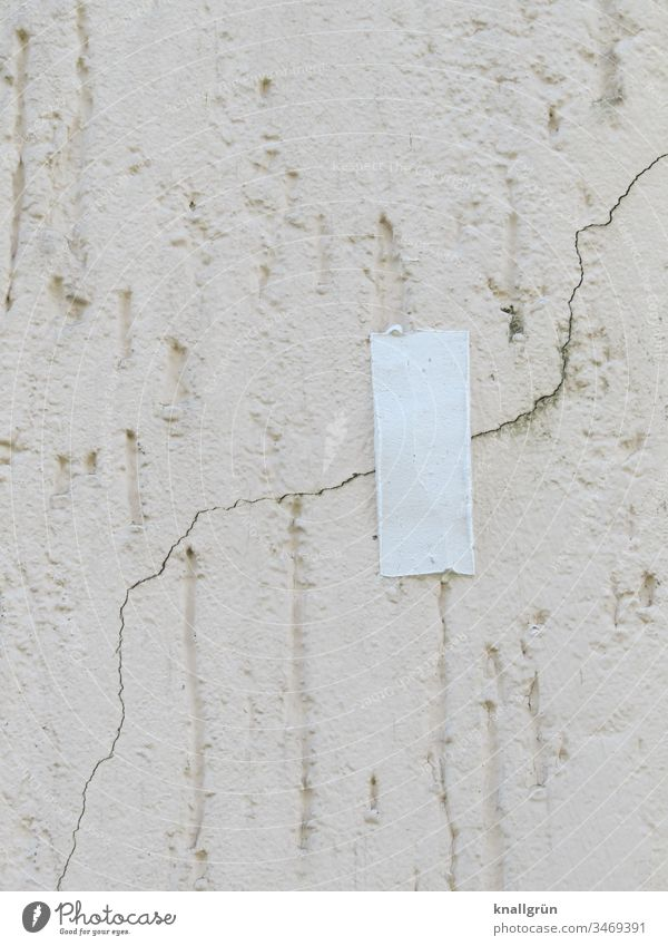 A piece of white adhesive tape over a crack in the plaster of a house wall Adhesive tape Wall (building) Protection Wall (barrier) Facade Plaster pasted over