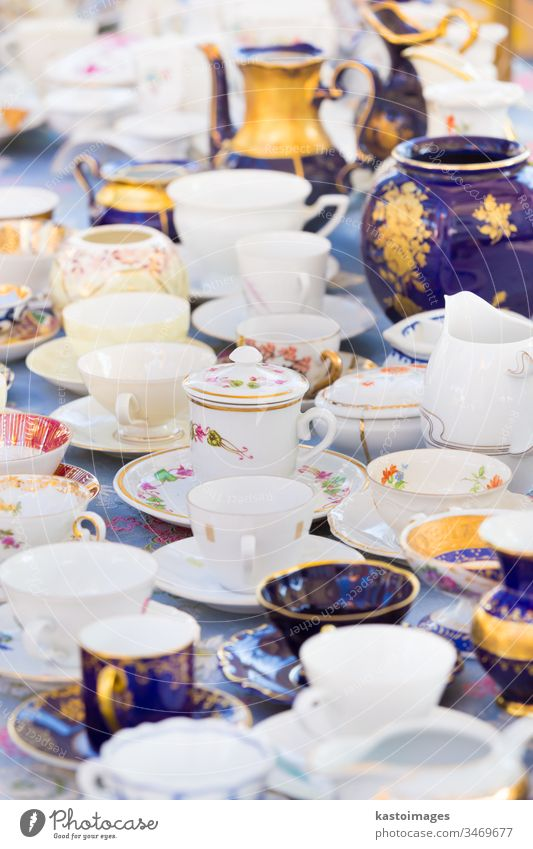 Sets of vintage china cups. porcelain china ware set of china white blue souvenir flea market city street antique business travel sell buy retail urban person