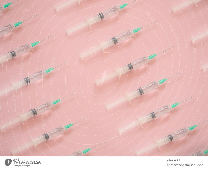 Syringe pattern on pink background antibiotic coronavirus covid-19 disease dose drug epidemic equipment health healthy hospital illness infection inject
