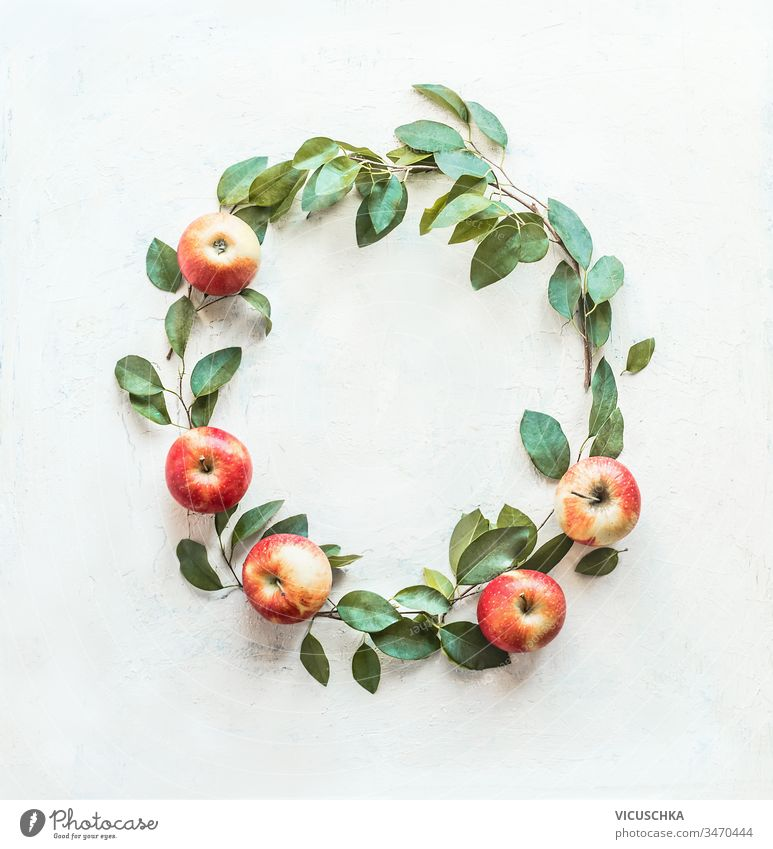 Beautiful circle frame made with apples and green leaves on white background. Fruits wreath. Harvesting . Apple season beautiful fruits harvesting apple season